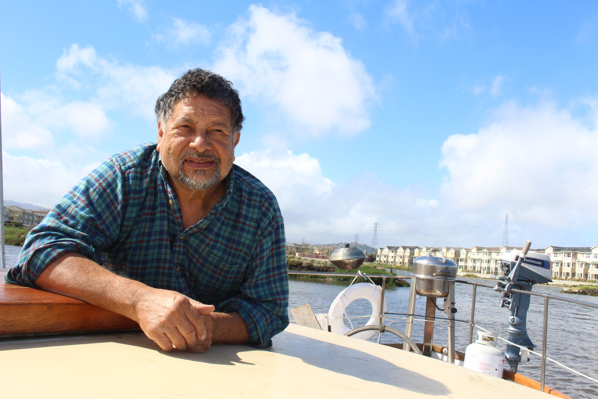 Emilio Diaz, 71, at the liveaboard he shares with his 20-year old son. Diaz, a Vietnam veteran, says he has stayed at Docktown for more than 15 years because he enjoys the community.