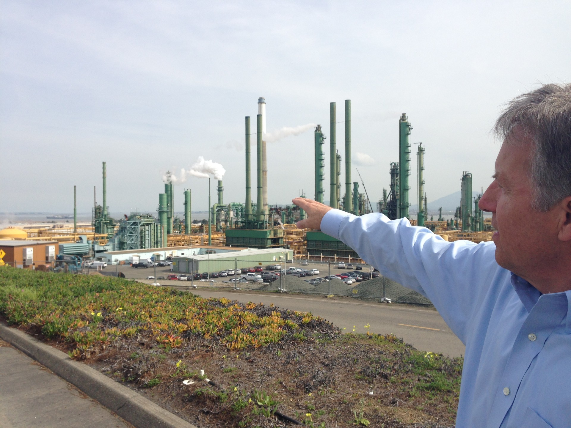 Chris Howe, safety director for Valero's Benicia refinery, points to where trains would come to deliver crude oil during a tour on March 2, 2016.