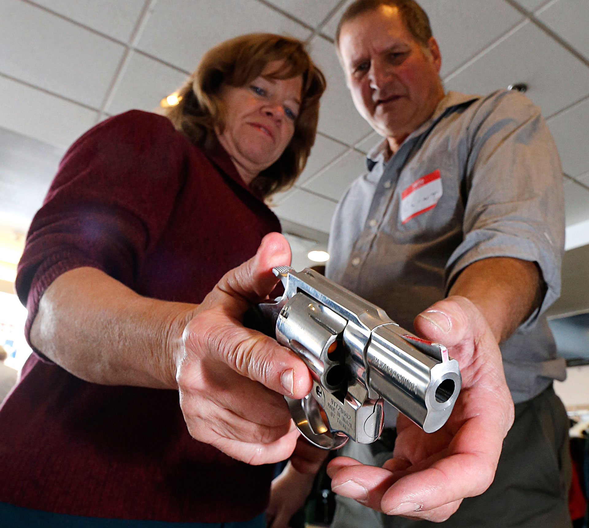 A teacher is shown how to handle a handgun at a concealed-weapons training class in Utah.