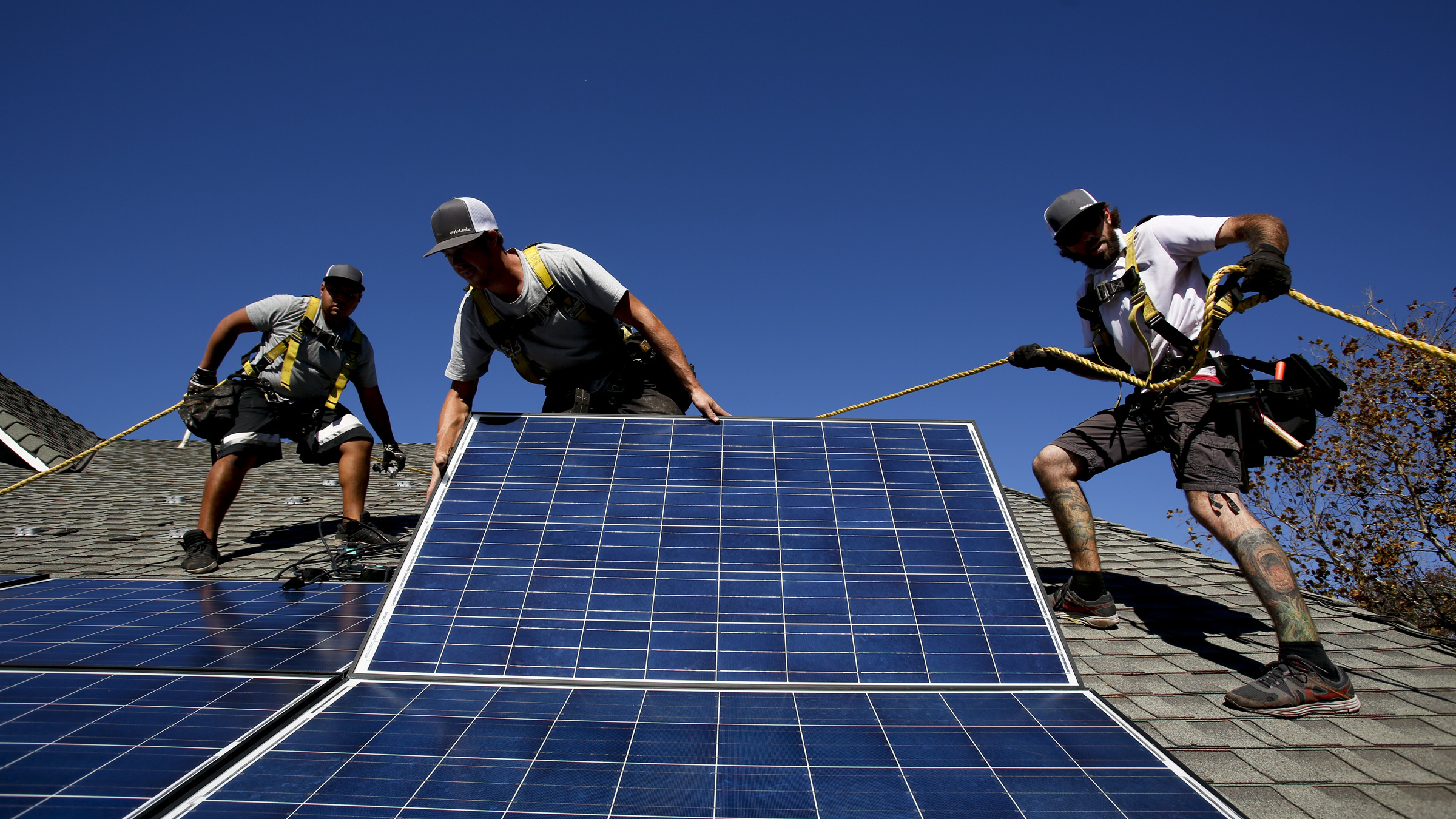 Workers install solar panels on the roof of a home in Camarillo in 2013. San Francisco has recently decided to start requiring rooftop solar systems — electrical or heating — on new construction up to 10 stories tall.
