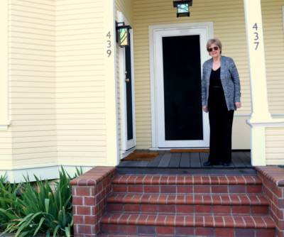 Jane Power stands in front of her home in Burbank, an unincorporated island in San Jose.