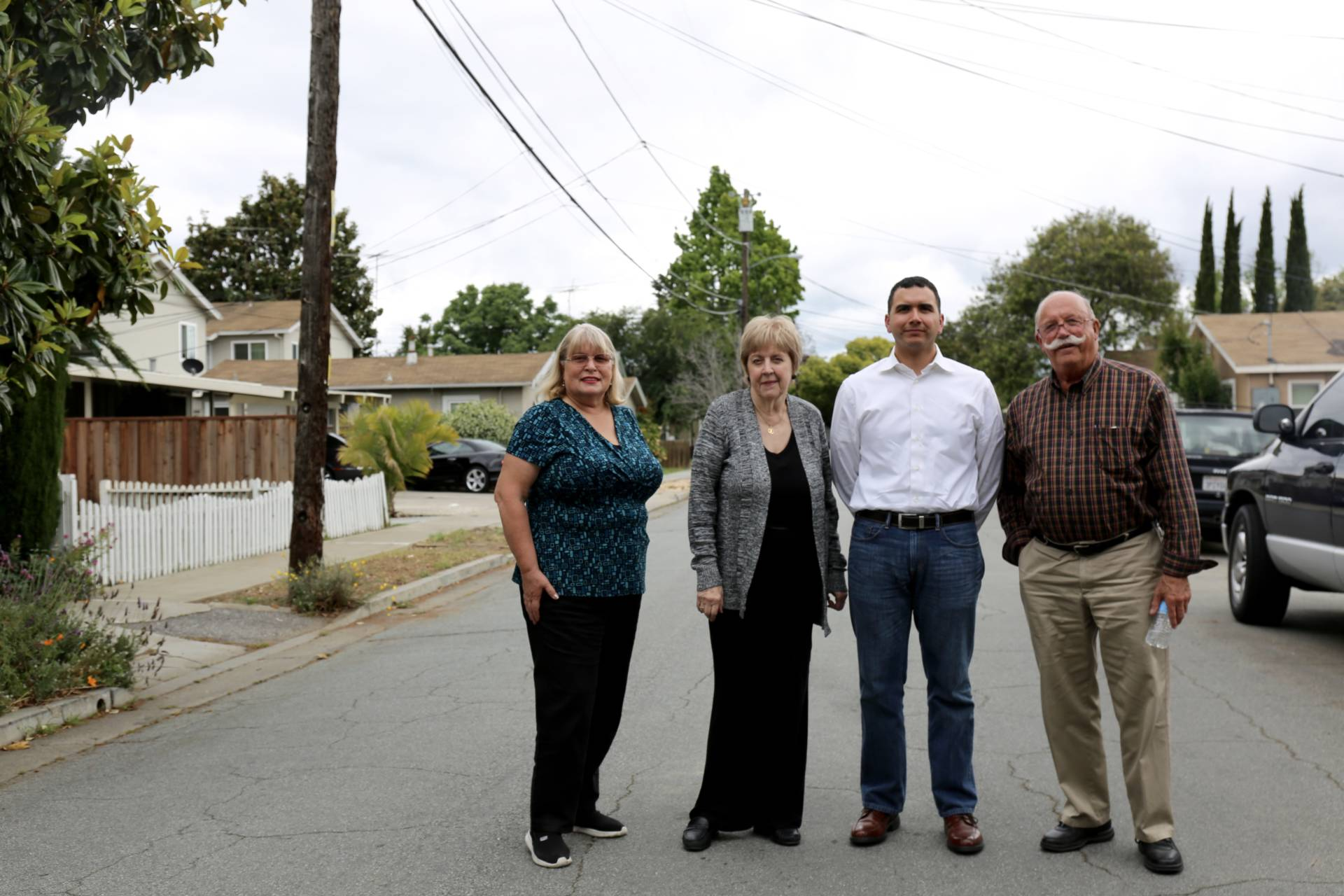 Henni Kaufman, Jane Power, Pete Sclafani and Ken Colson, members of the Burbank Community Council, stand in front of Power's home in Burbank.