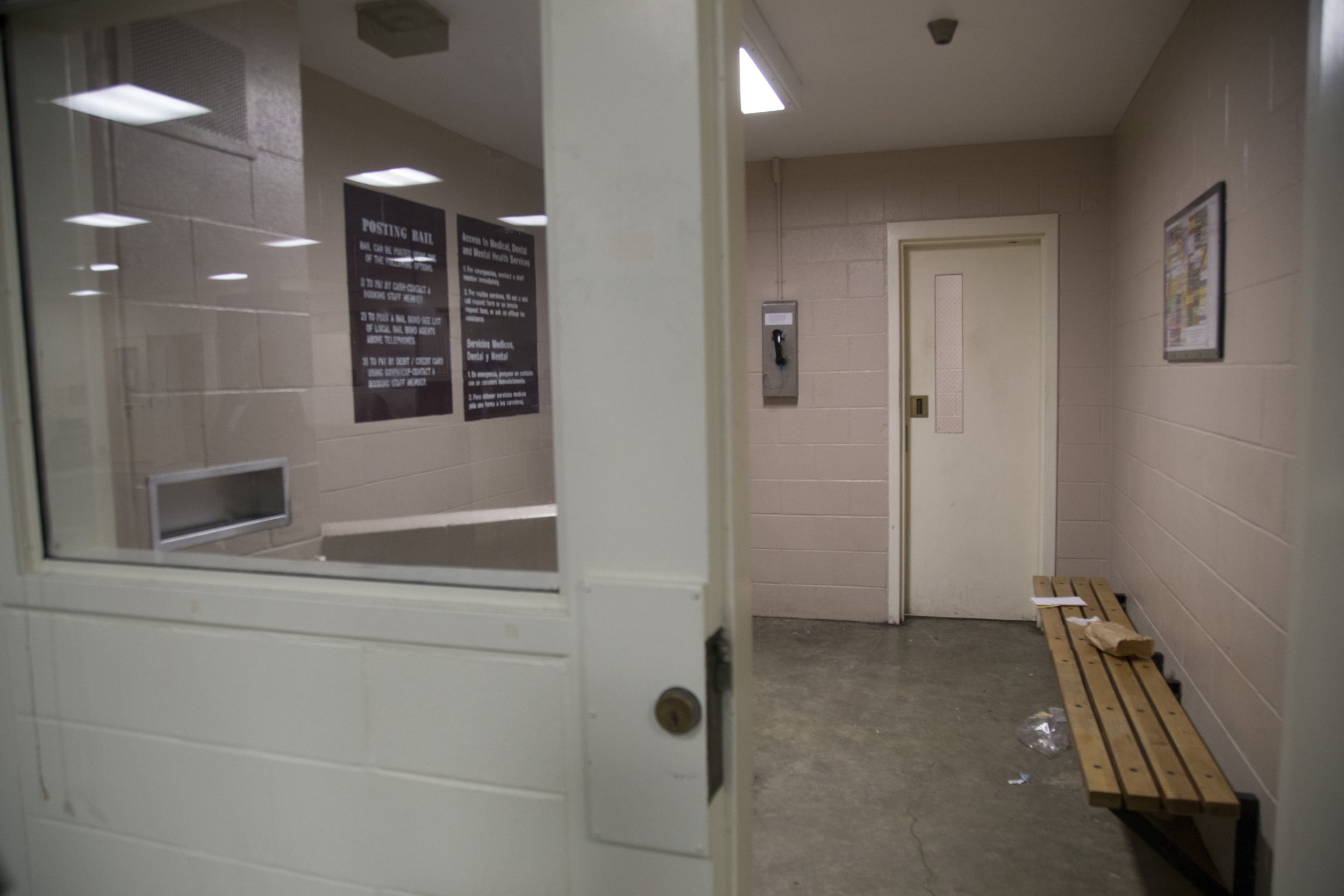 Signs inform inmates about their rights to health and mental health treatment in Sonoma County Main Jail's booking area.