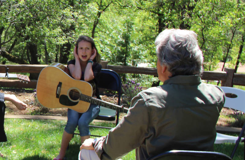 Daisy Kerr performs vocal exercises during a workshop with musician Keith Little at her home in Placerville.