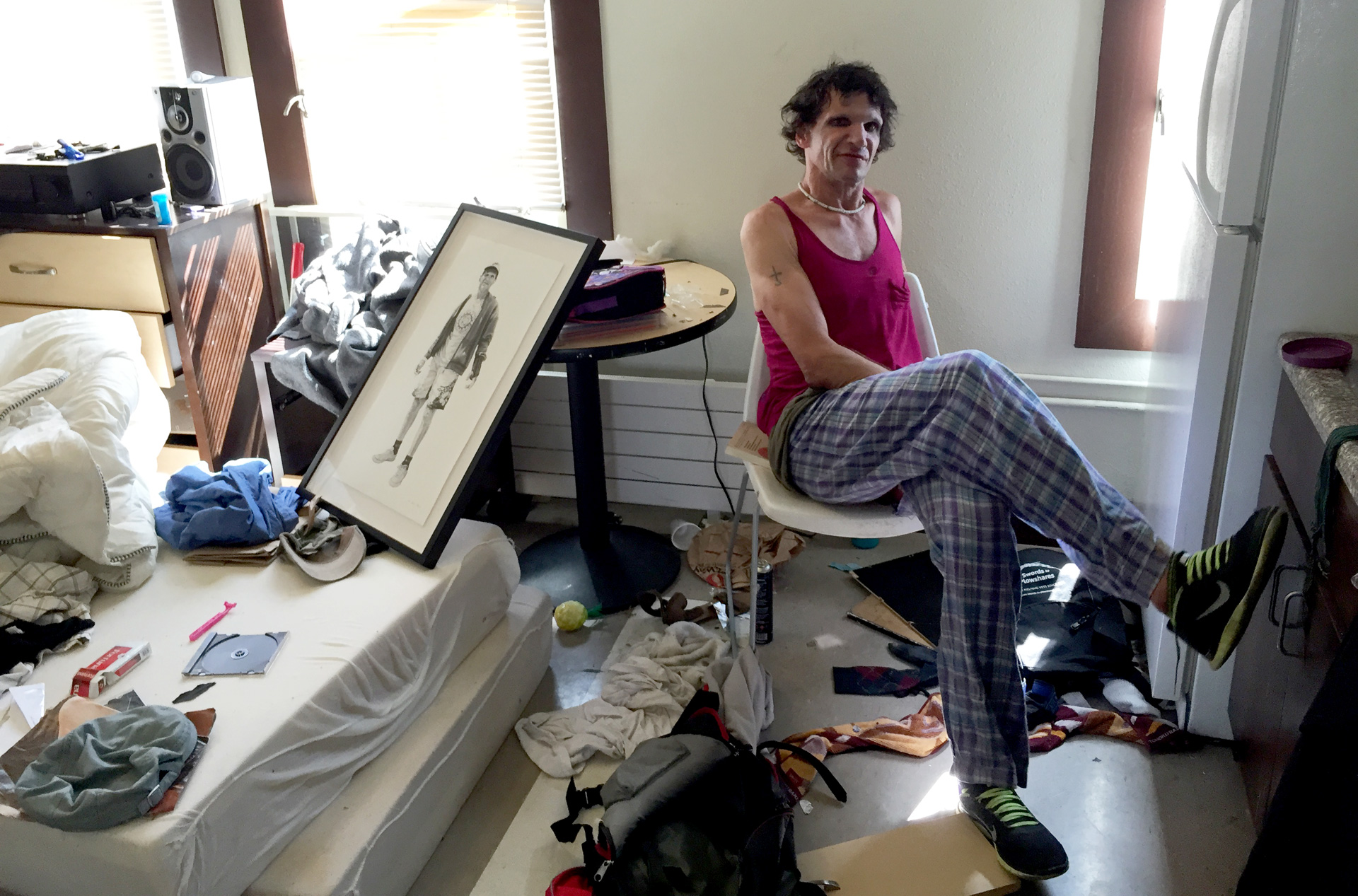 George Arthur sits in his new studio apartment in San Francisco, after spending 25 years living in shelters and on the streets.