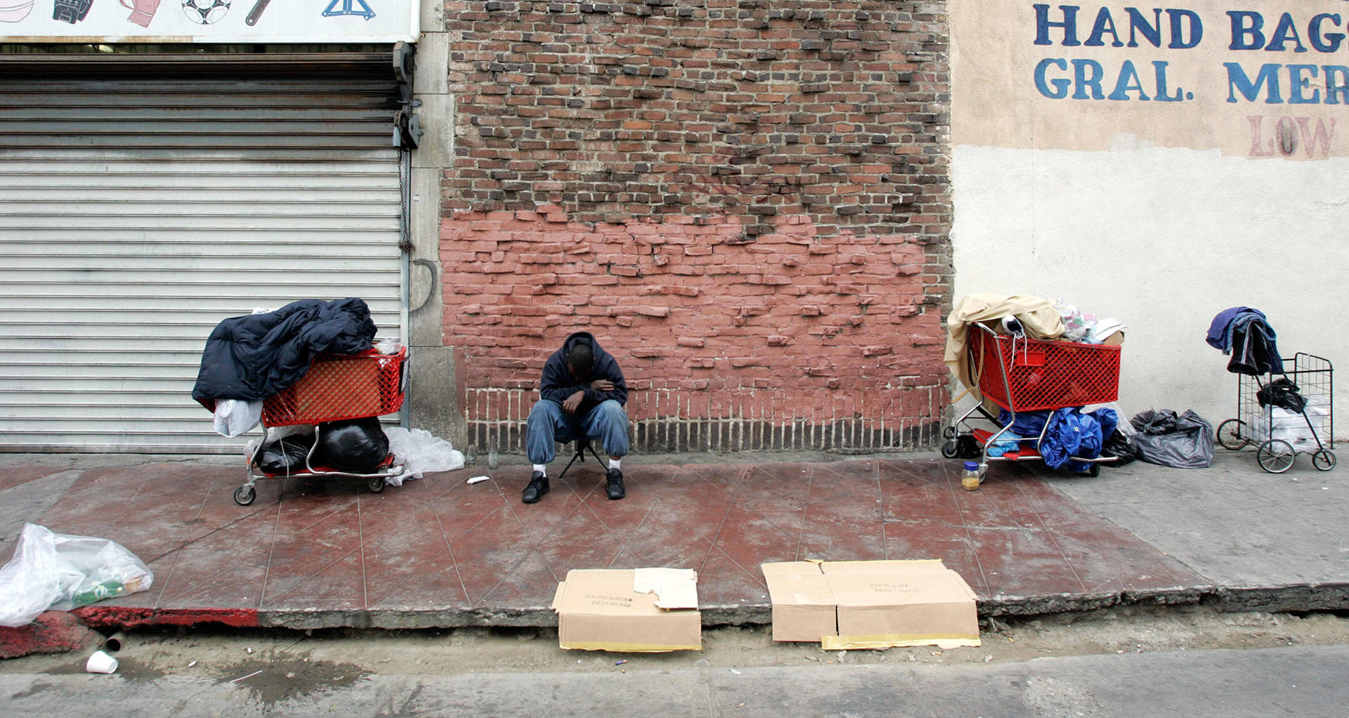 A homeless man waits to get in line for food distribution in Los Angeles. HECTOR MATA/AFP/Getty Images