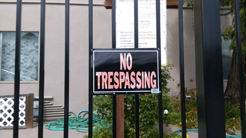 "Fences and ""No Trespassing"" signs appear throughout Smith's street today."