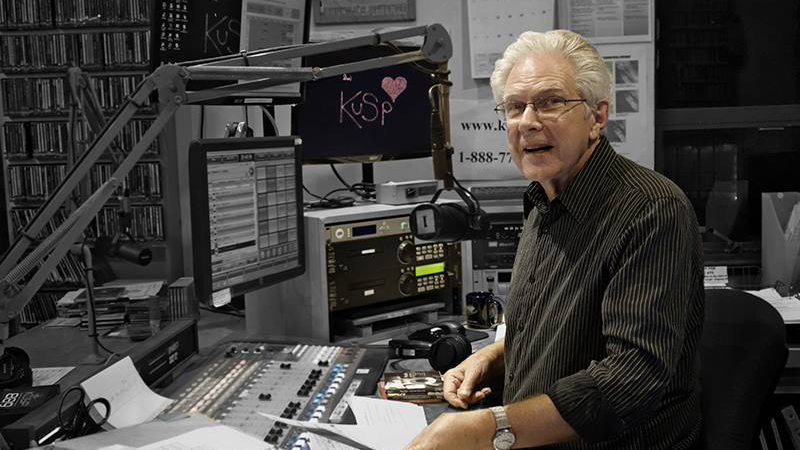 KUSP DJ Mike Lambert at the mixing board during his show 'In The Groove.'