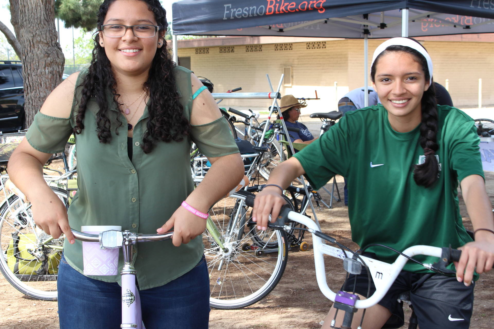 """Josemelli Ruiz, 15, and her sister Joanna Ruiz, 13, attend a free bike repair event at a park in south Fresno. Both teens consider biking to school """"too dangerous"""" due to a lack of bike lanes."""