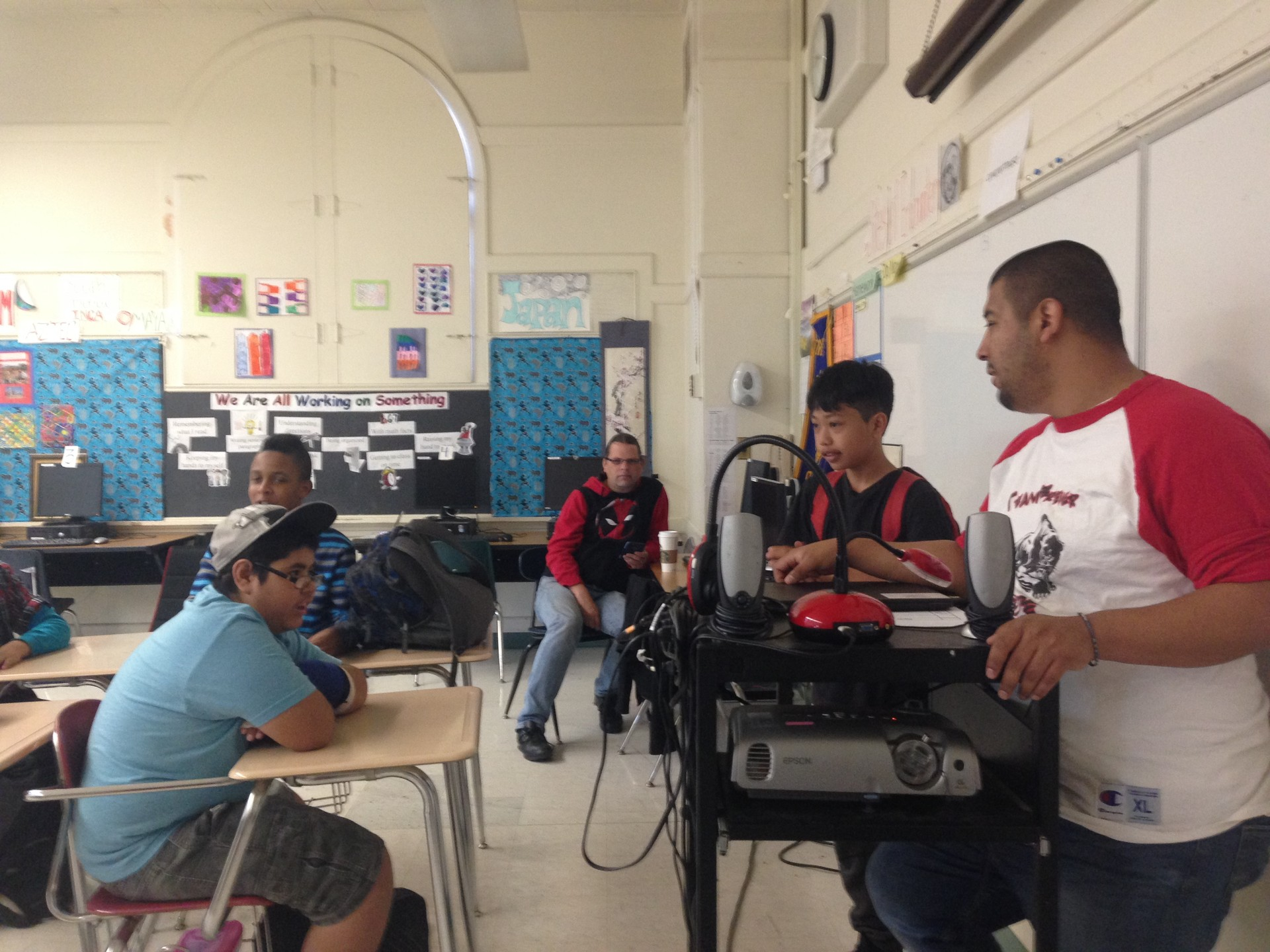Special Education teacher Ismael Amendariz speaks to some of his students at Edna Brewer Middle School on May 20, 2016.