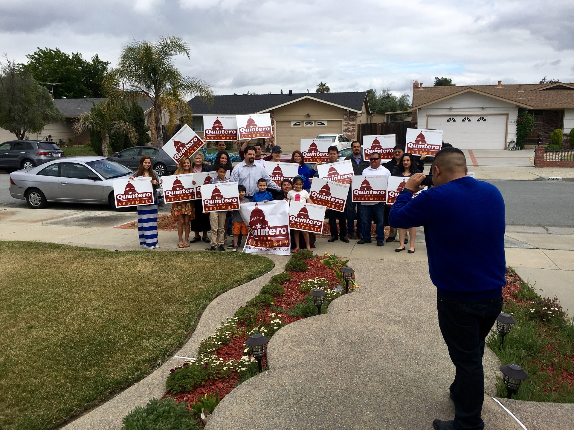 A group shot before volunteers & family members go door-to-door to get out the Latino vote for Assembly candidate Andres Quintero.