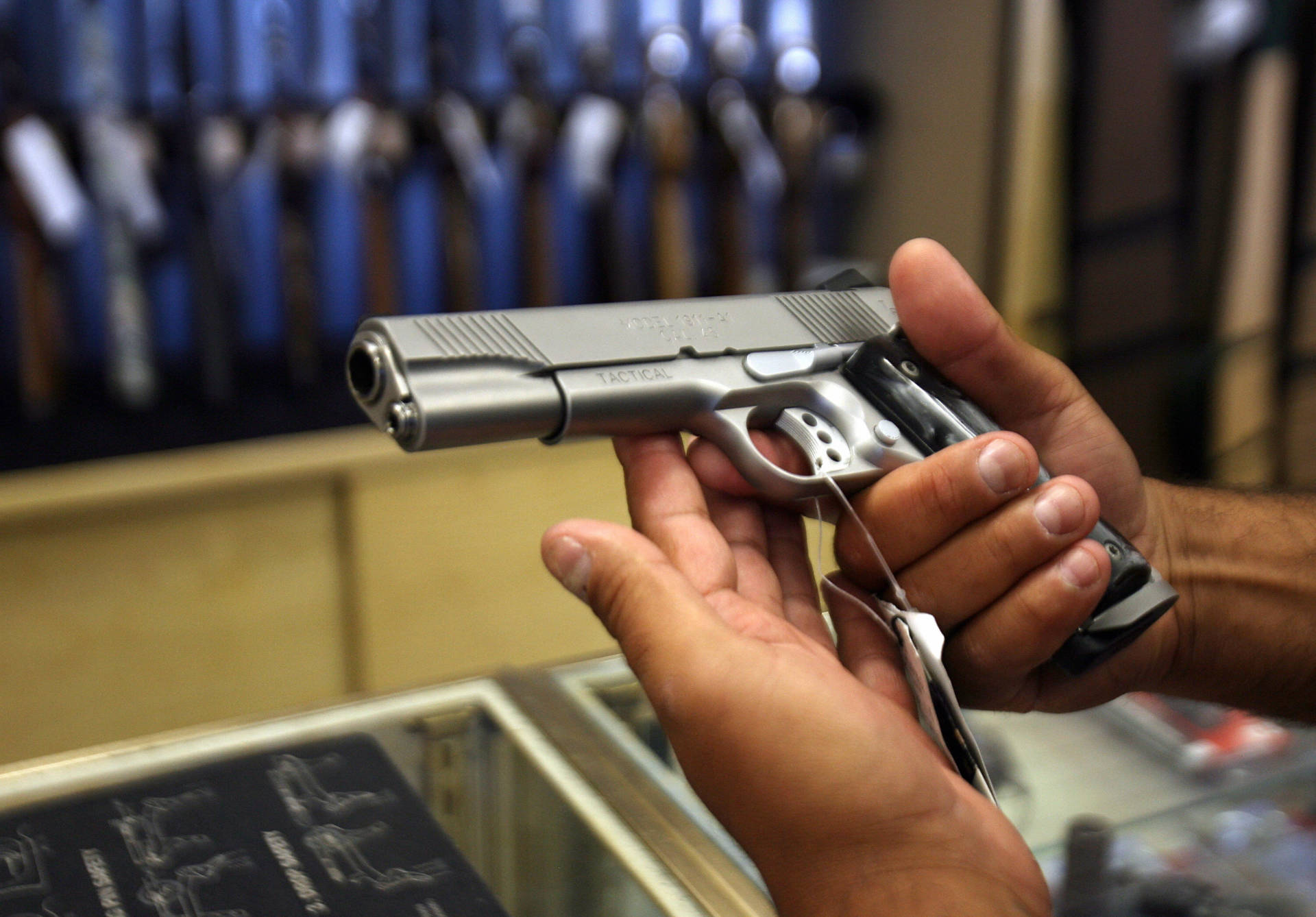 Glendale, UNITED STATES: A man chooses a gun at the Gun Gallery in Glendale, California, 18 April 2007