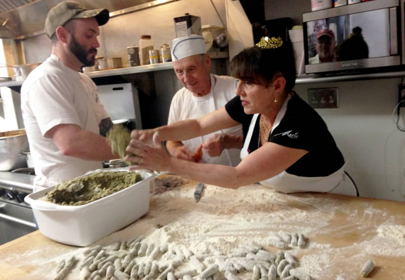 Joe Gonzalez (L), Clemente Cittoni, and Joanne Cittoni Gonzalez make malfatti together in an industrial kitchen at the back of a Napa liquor store.