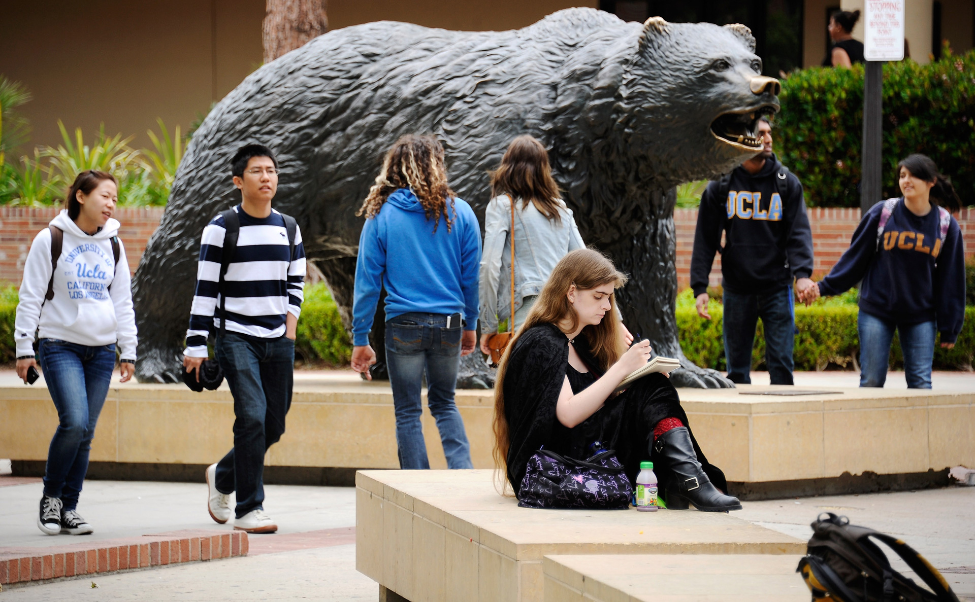 Students walk near the Bruin Bear statue on the UCLA campus.