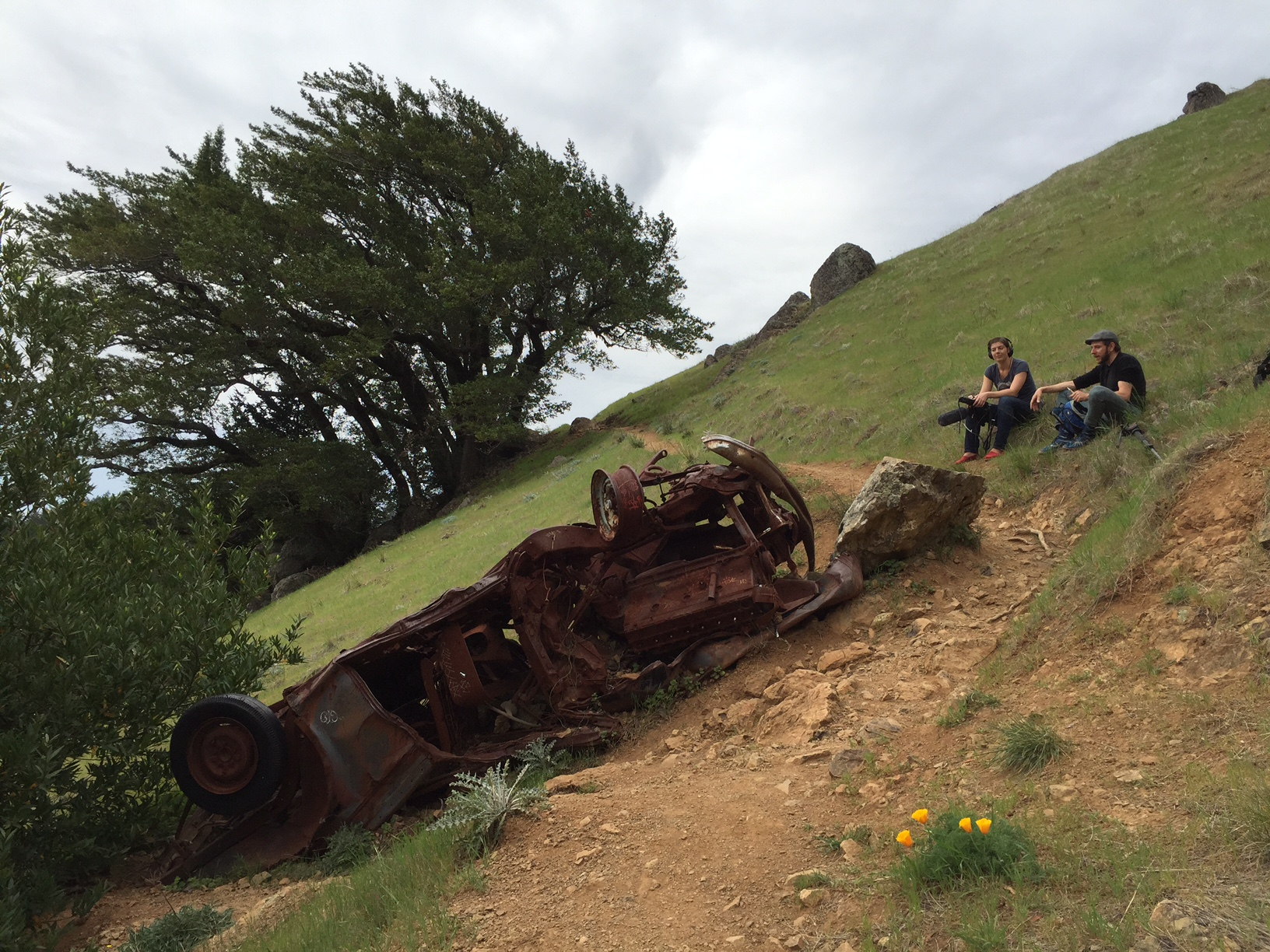 Reporter Katrina Schwartz and KQED listener Kermit Robbins survey the wreck on the Bolinas Ridge Trail (formerly known as the Coastal Trail.)