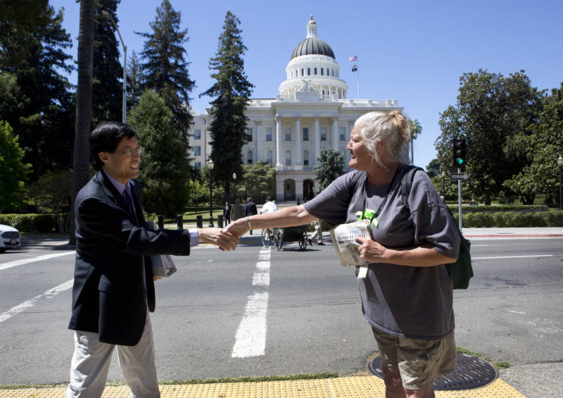 State Sen. Richard Pan (D-Sacramento) shakes hands with Debbie Bartley.