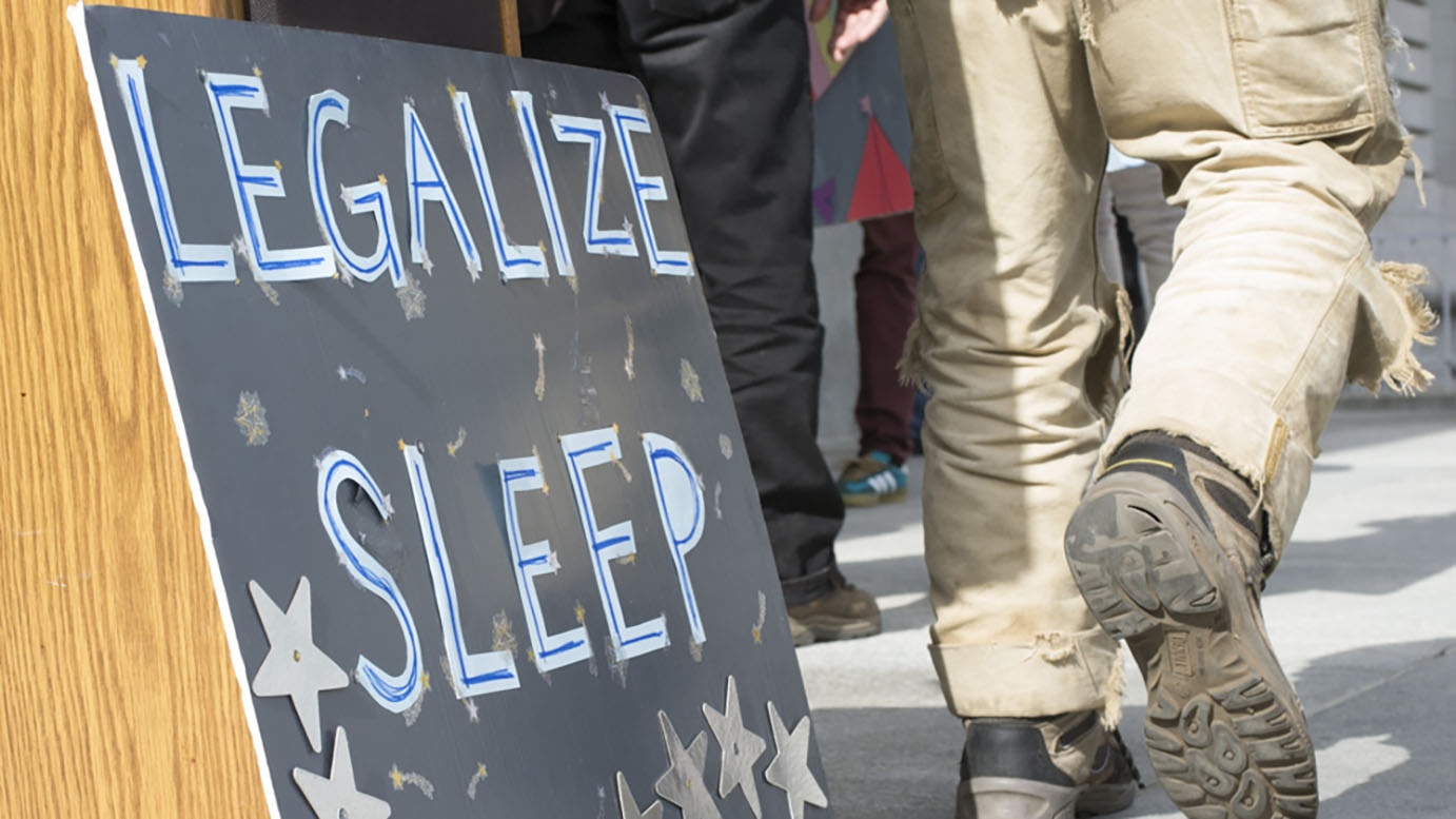 "A homemade sign that reads ""Legalize Sleep."""
