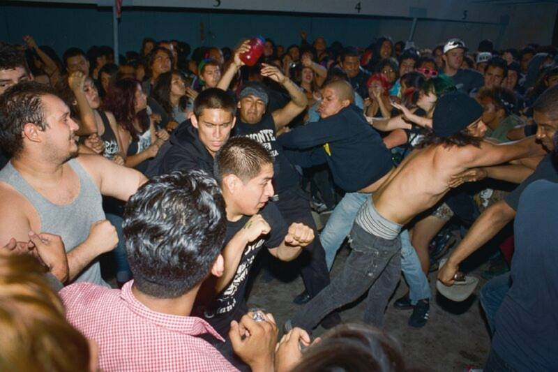 A moshpit in full force at backyard punk show somewhere in L.A.