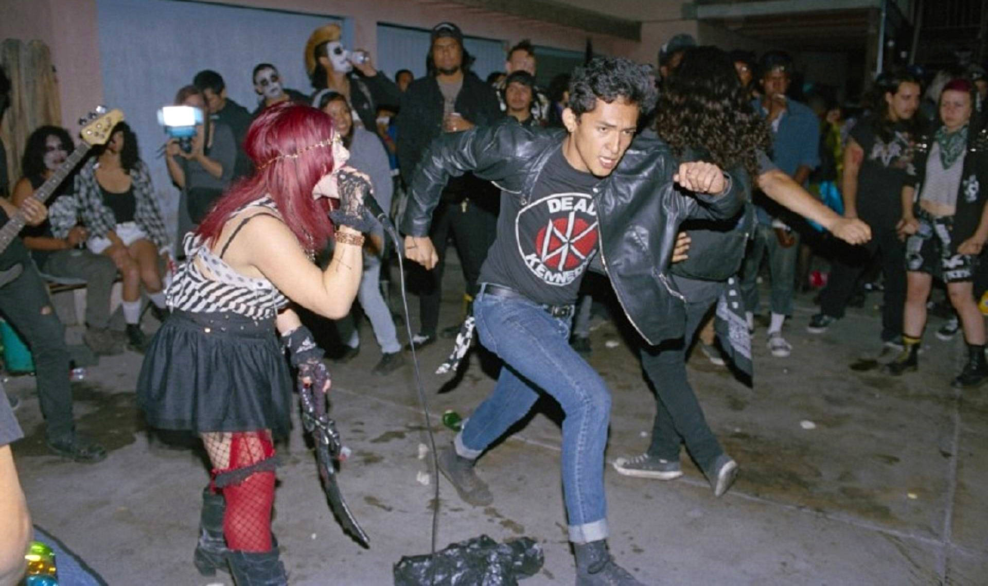 The band CXA performs at a backyard show.  Photo: Angela Boatwright