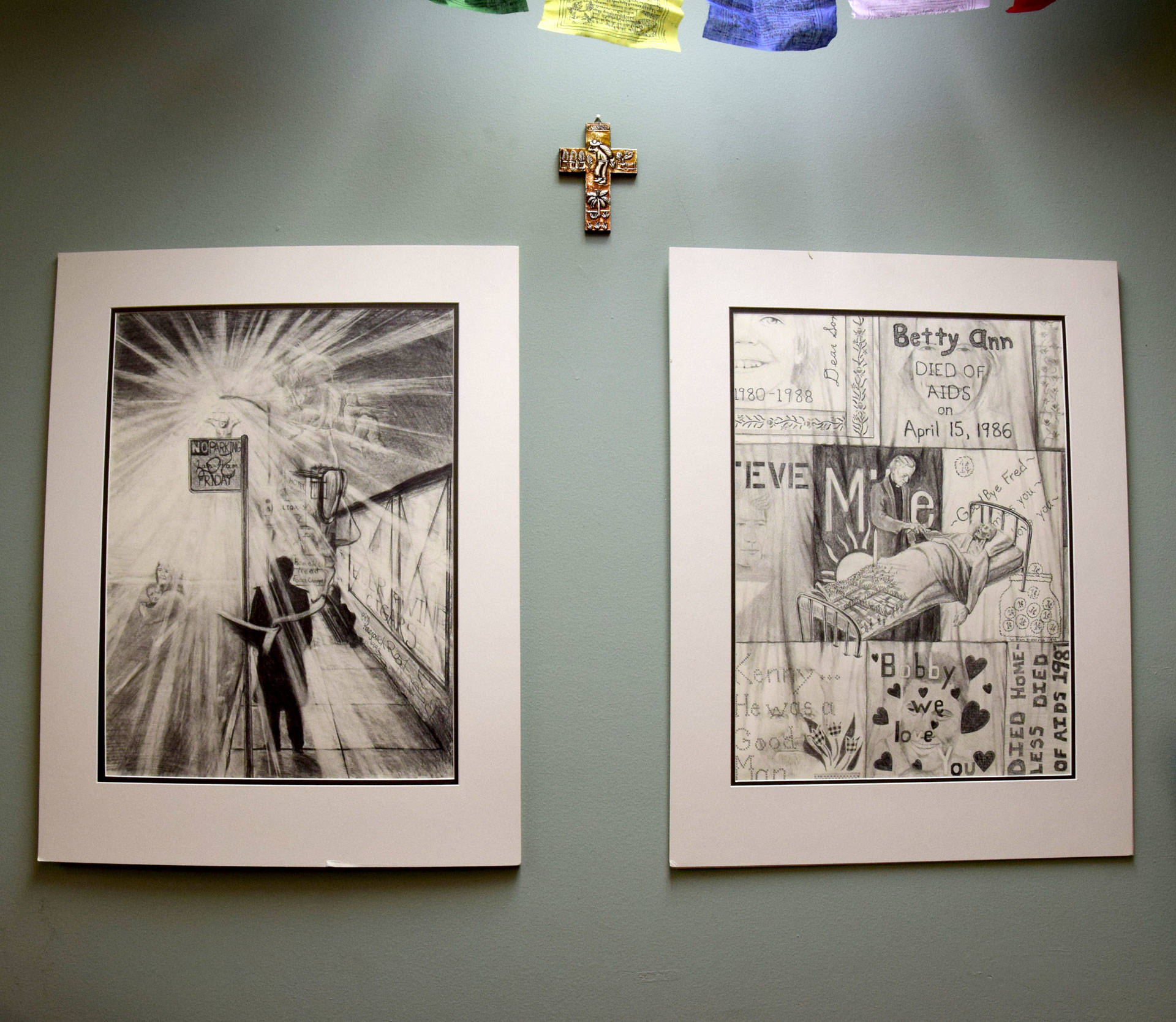 Two drawings hang at the San Francisco Night Ministry's headquarters, where head minister Lyle Beckman led volunteers in prayer before the night's crisis line opened and before he hit the streets.  Natalie Yemenidjian/KQED