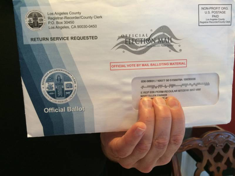 Steve Masar holds a ballot for a woman who used to live at his address in Pasadena. Mary Ellen Parker passed away two years ago.
