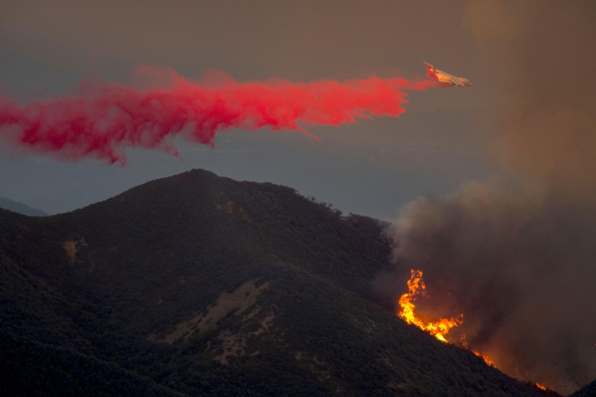 A firefighting BAe-146s jet drops fire retardant, June 18, 2016 at the Sherpa Fire near Santa Barbara.