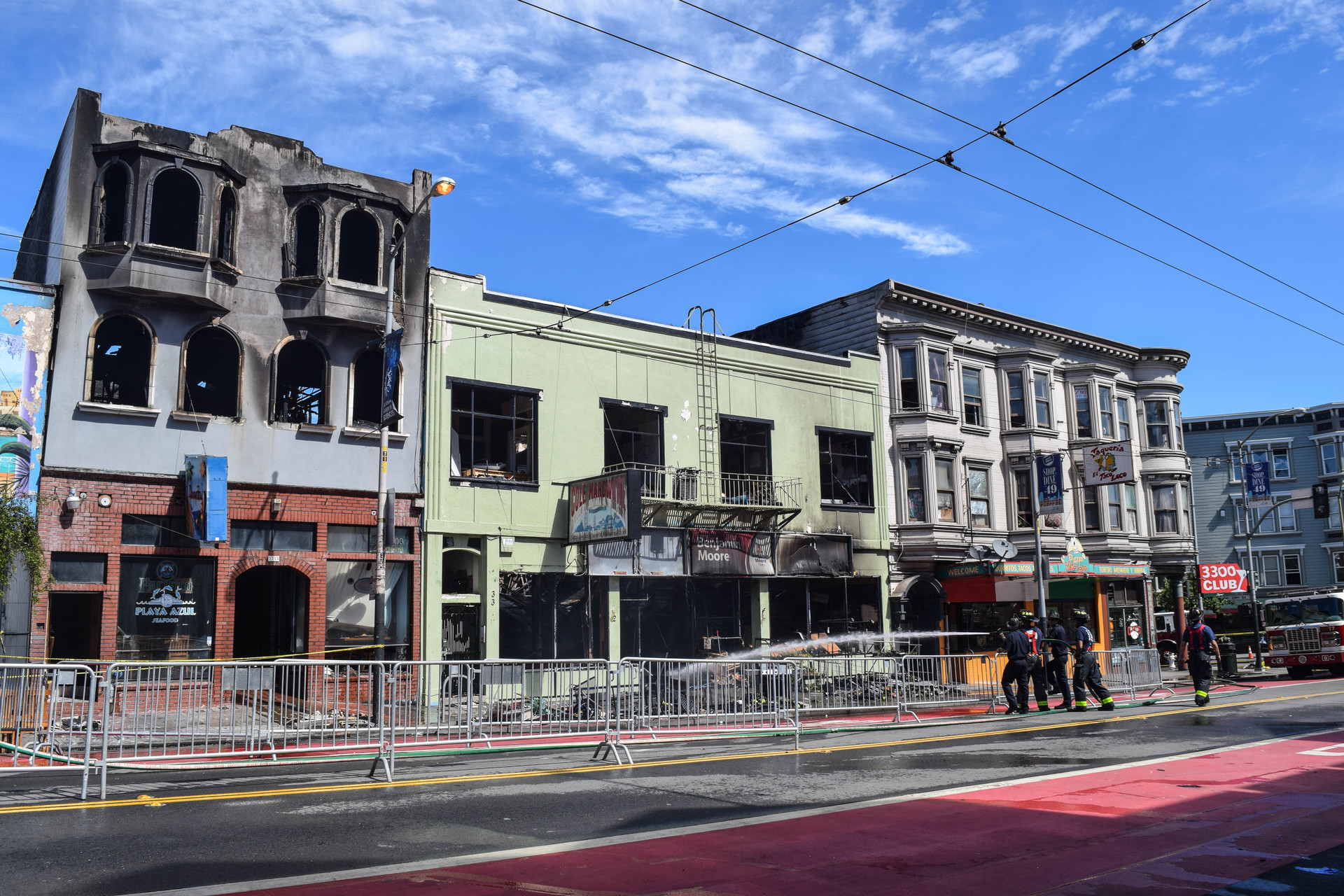 The aftermath on June 19 of a 5-alarm fire that started the previous day in San Francisco's Bernal Heights neighborhood, burned six buildings and displaced 57 people.