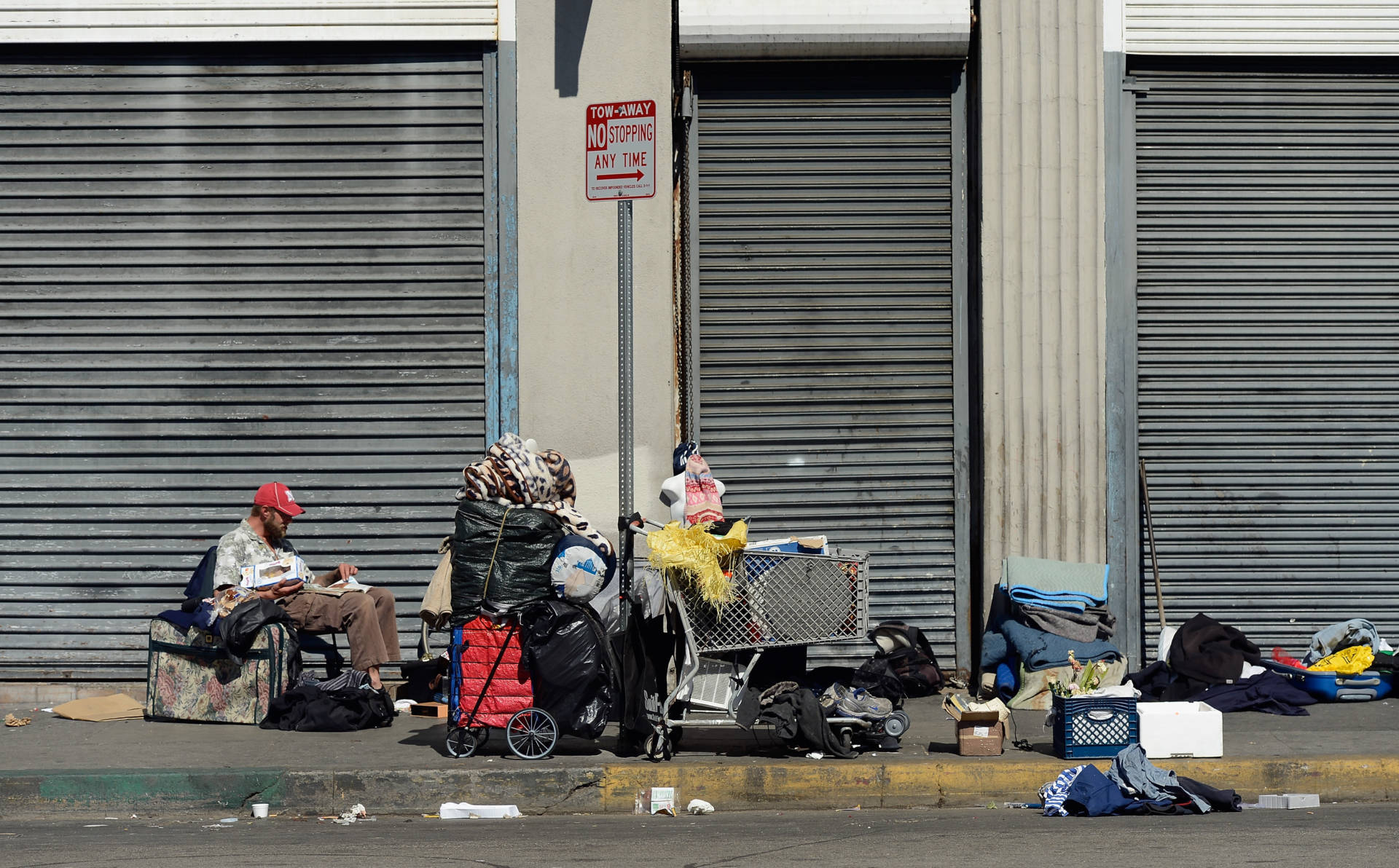 LOS ANGELES, CA - FEBRUARY 28: Homeless people rest on a public sidewalk February 28, 2013 in downtown skid row area of Los Angeles, California.