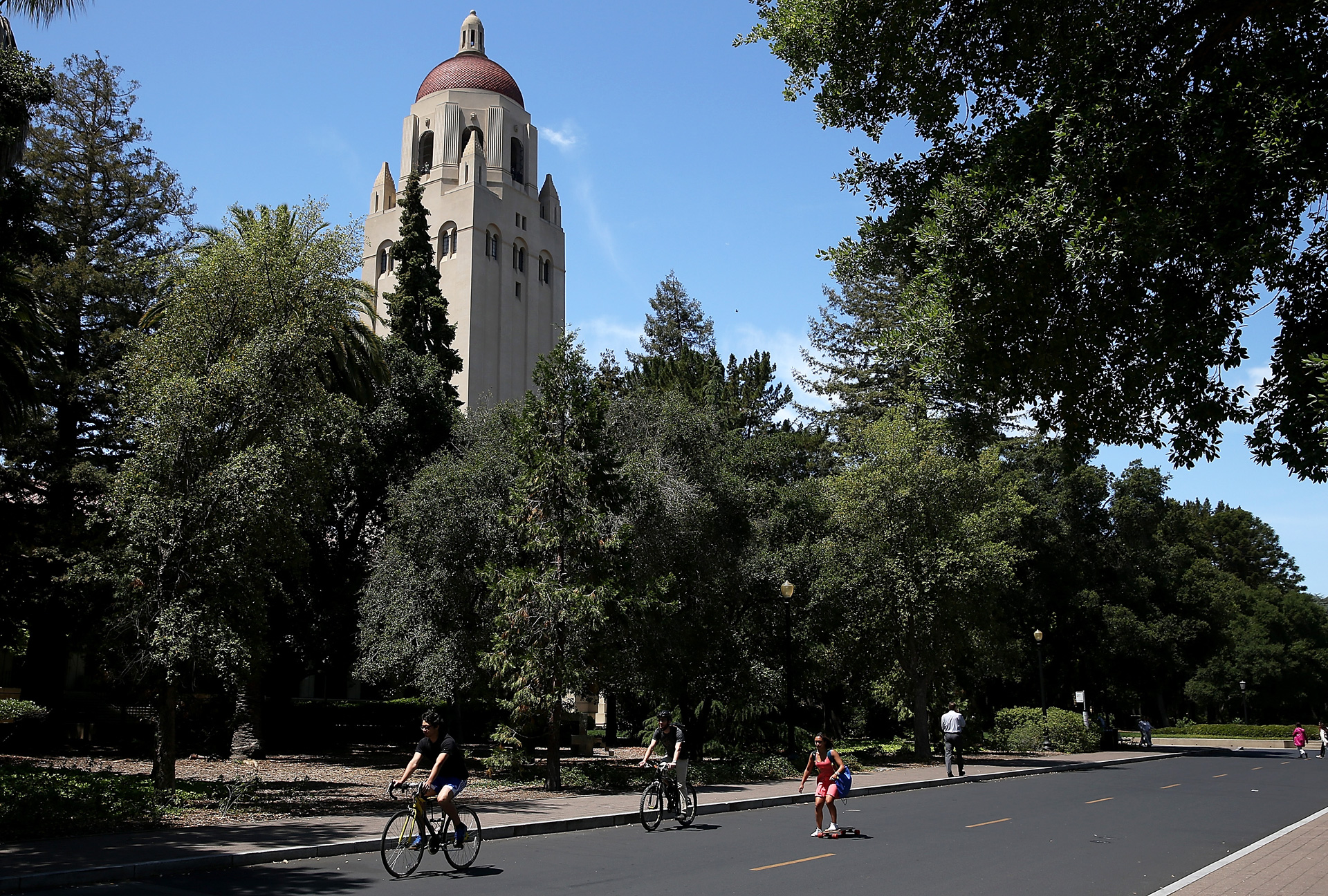 People ride bikes past Hoover Tower on the Stanford University campus.