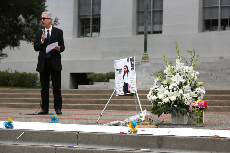 UC Berkeley Chancellor Nicholas Dirks stands behind a memorial for Tarishi Jain during a vigil for the 19-year-old UC Berkeley student which was held on UC Berkeley's campus in Berkeley, Calif. on July 5, 2016. Jain was one of the victims of an attack at a Dhaka cafe in Bangladesh on July 2,2016.