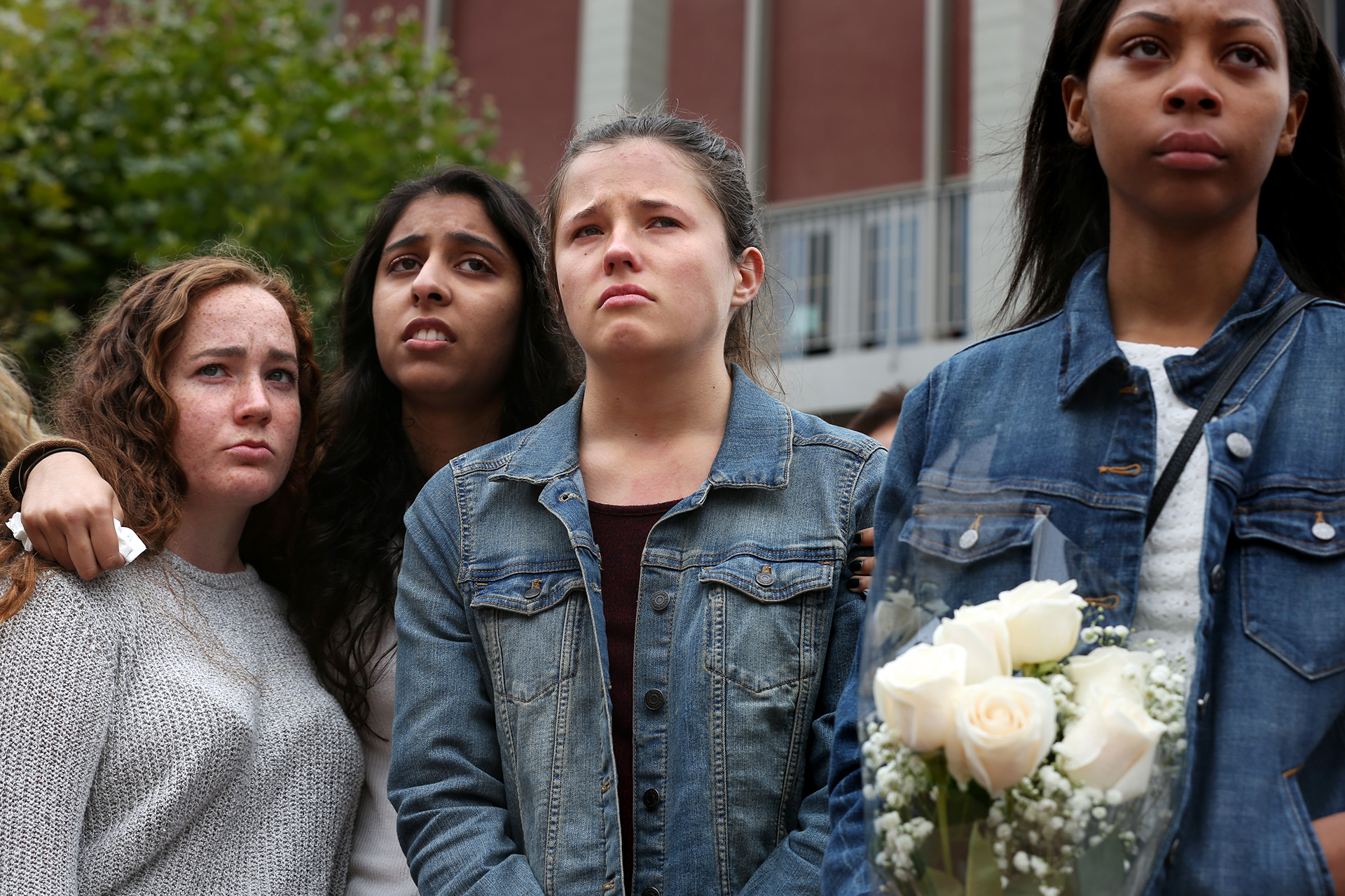 Hannah Rowe (center), former roommate of Tarishi Jain stands with fellow friends Mackenzie Monroe (left), Savreen Saran and Aaliyah Parker during a vigil for 19-year-old UC Berkeley student Tarishi Jain, one of the victims of an attack at a Dhaka cafe in Bangladesh on July 2,2016. The vigil was held on UC Berkeley's campus in Berkeley, Calif. on July 5, 2016.