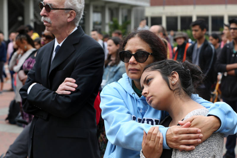 A young student is consoled during a vigil for 19-year-old UC Berkeley student Tarishi Jain, one of the victims of an attack at a Dhaka cafe in Bangladesh on July 2,2016. The vigil was held on UC Berkeley's campus in Berkeley, Calif. on July 5, 2016.