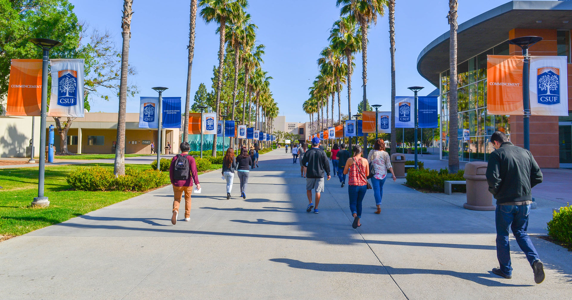 Students walk on the campus of California State University, Fullerton, one of seven Cal State campuses implementing Project Rebound.
