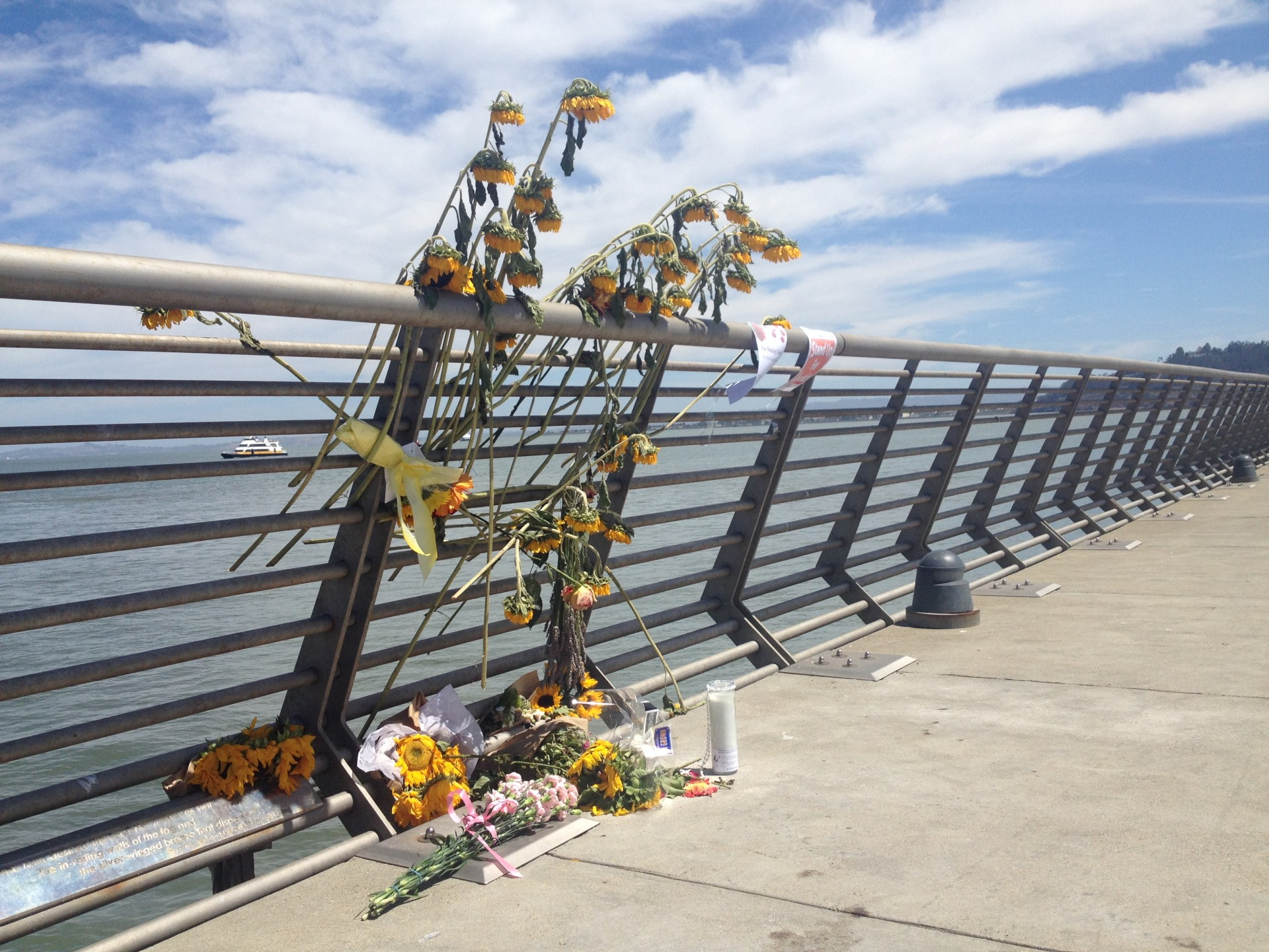 A memorial for Kate Steinle on San Francisco's Pier 14, where she was fatally shot on July 1.