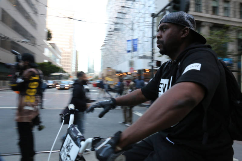 Jason Juniel rides at the front of the march from Embarcadero to City Hall Friday evening in San Francisco.