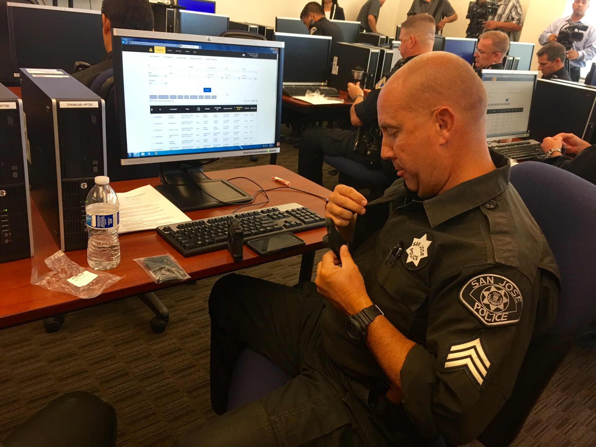 Sgt. Sean Pritchard who works in San Jose Police Department's gang unit, attaches his body worn camera during a four hour training session.