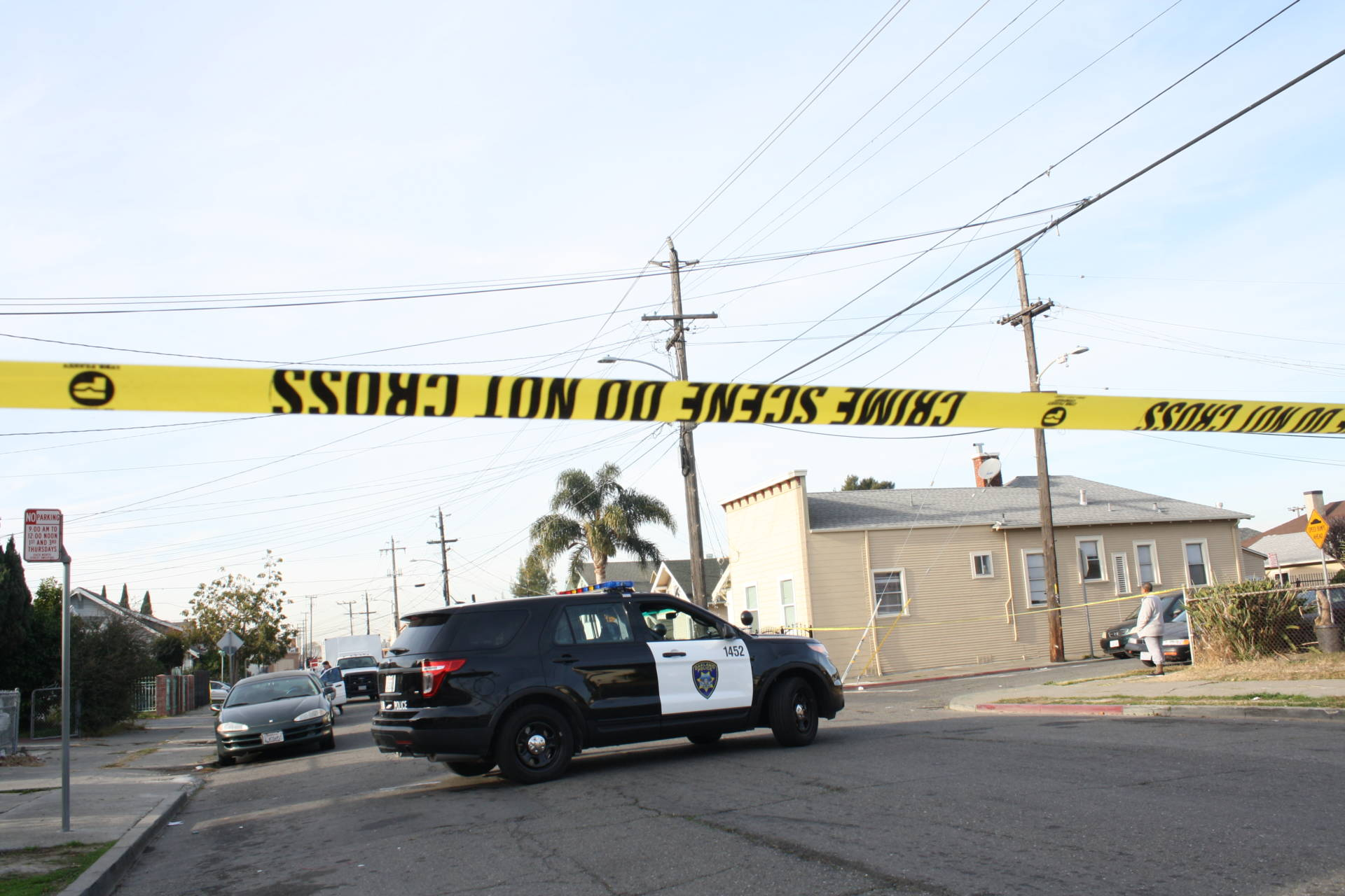An Oakland Police Department vehicle parked at a crime scene.