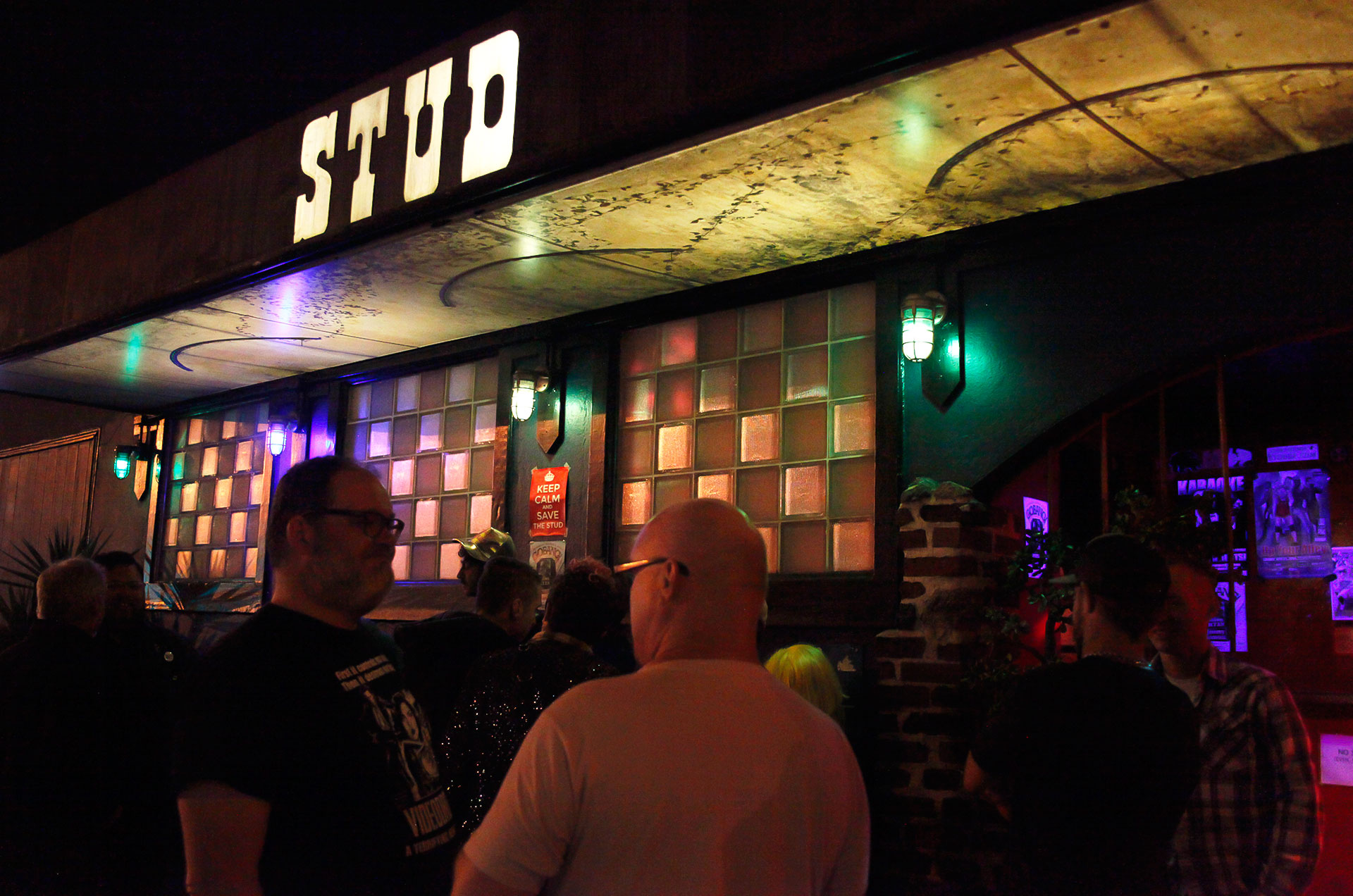 Patrons of the Stud Bar mingle outside during an intermission for the night's cabaret show.