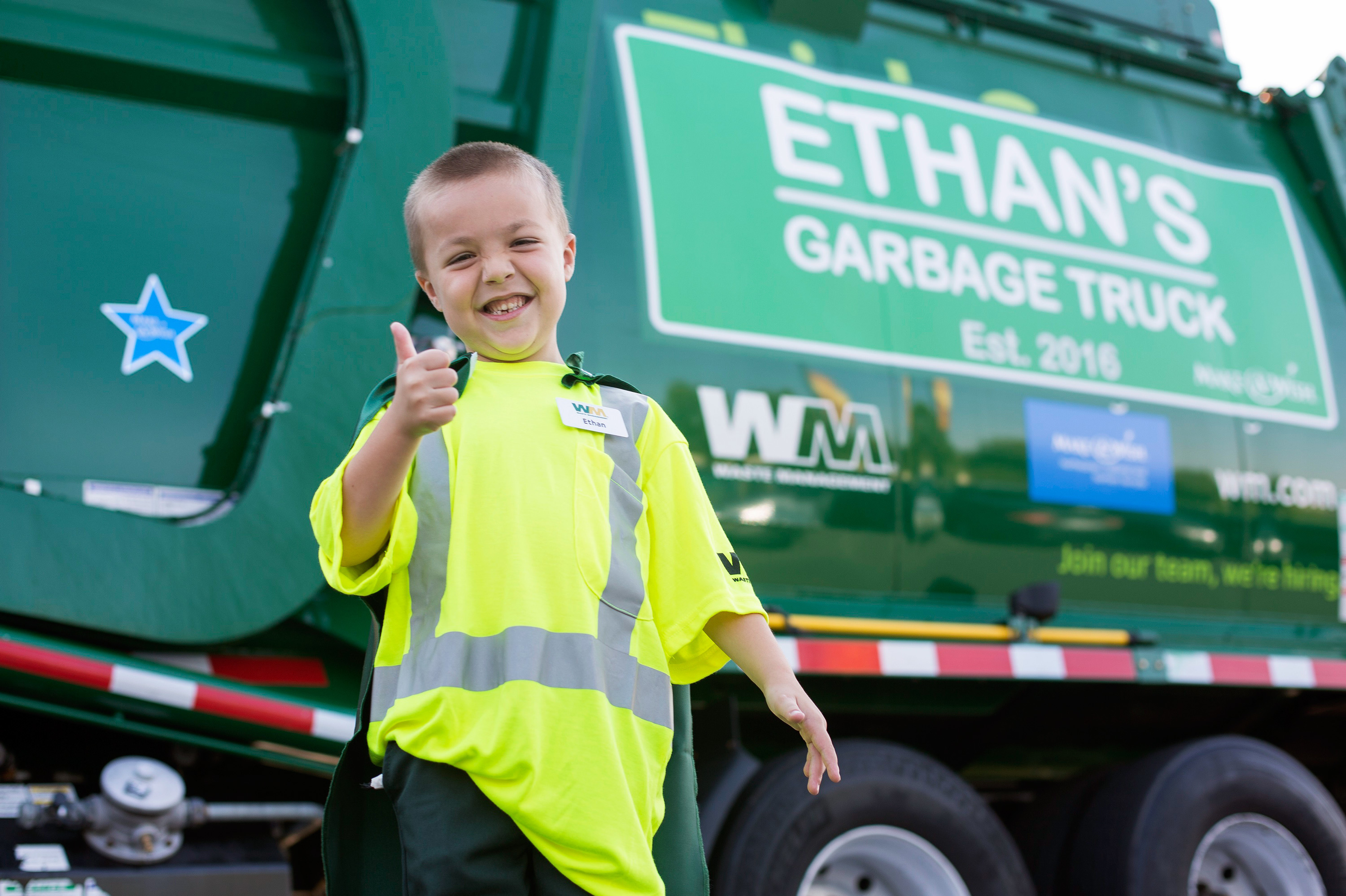 Ethan Dean, a 6-year-old boy with cystic fibrosis, rode in a garbage truck in Sacramento on Tuesday as part of an event organized by the Make-a-Wish Foundation and local sponsors.