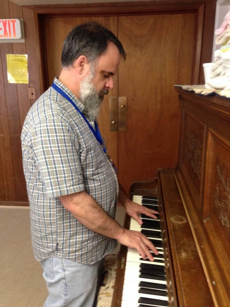 Blair Chenoweth plays the piano at Mariposa United Methodist Church where he now volunteers.
