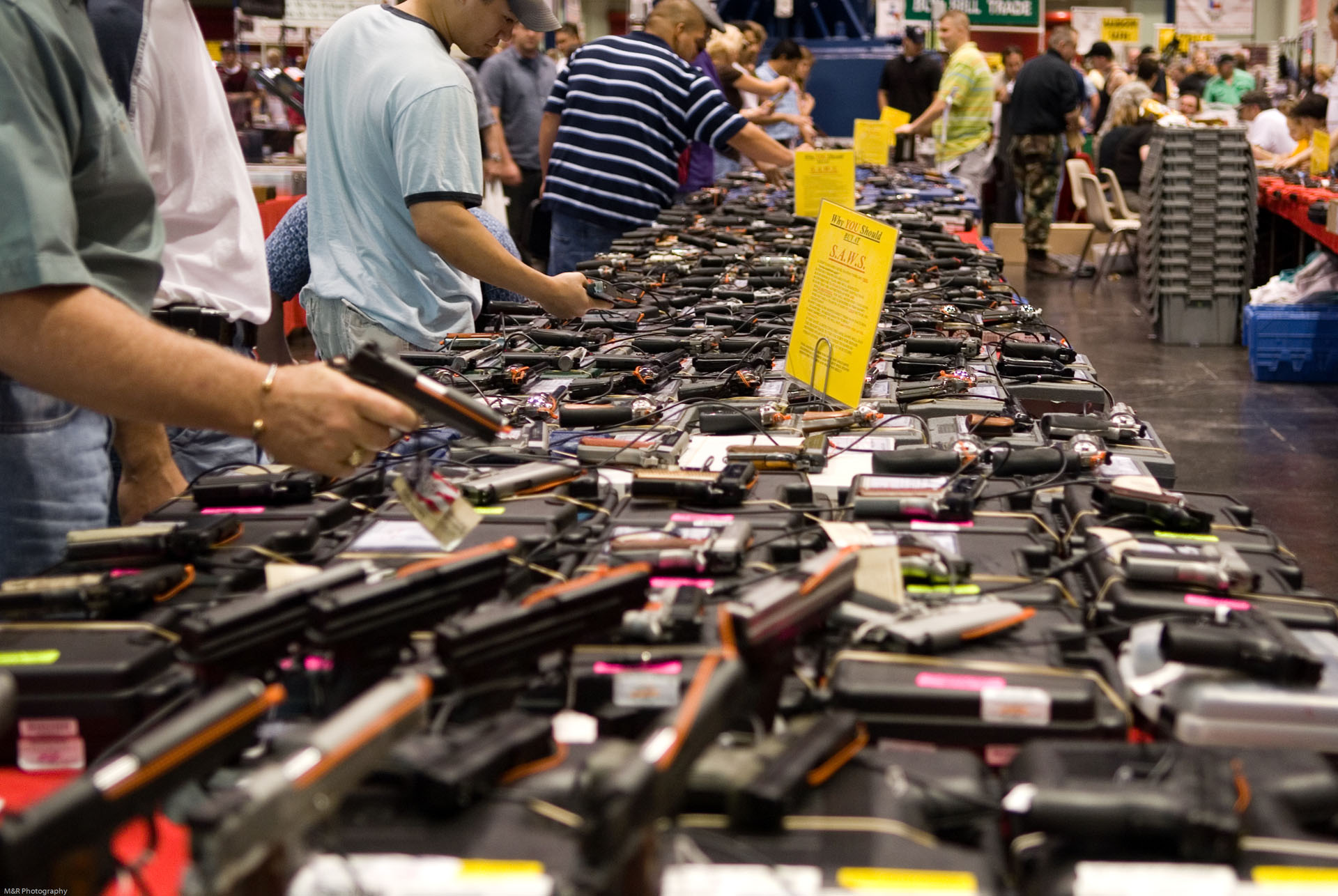 Customers shopping at a gun show