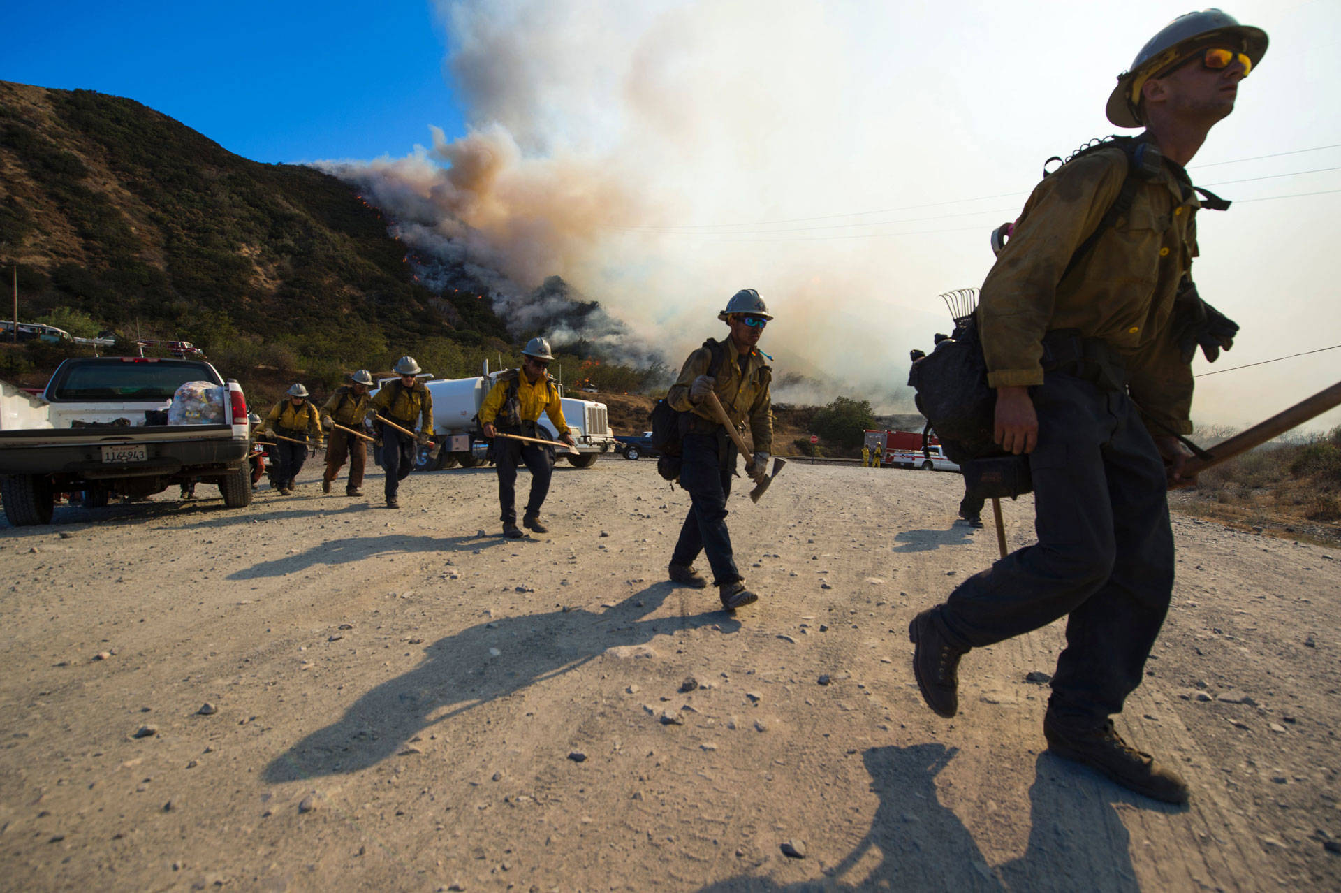 Firefighters prepare to clear a hot spot at the Blue Cut Fire near Wrightwood on Aug. 17, 2016. The blaze destroyed nearly 100 homes and forced the evacuation of 80,000 people in San Bernardino County. Robyn Beck/AFP/Getty Images