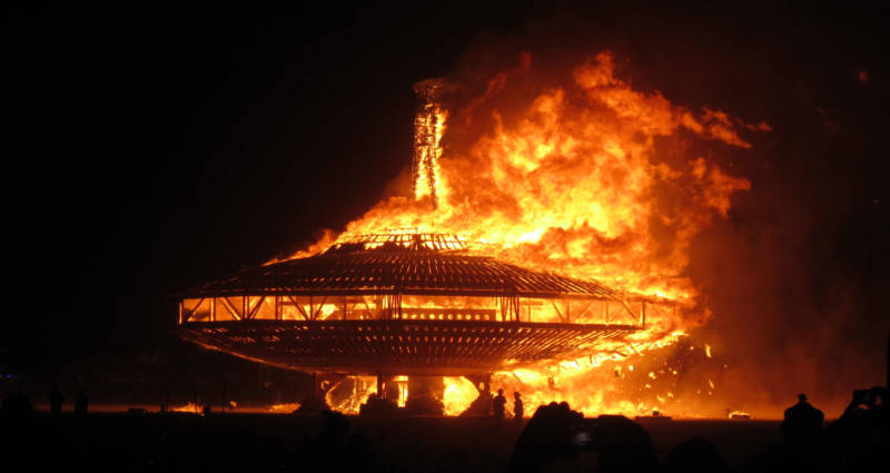 The UFO at Burning Man 2013 goes up in flames.