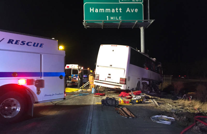 The charter bus struck a highway sign, which sheared it nearly in half.