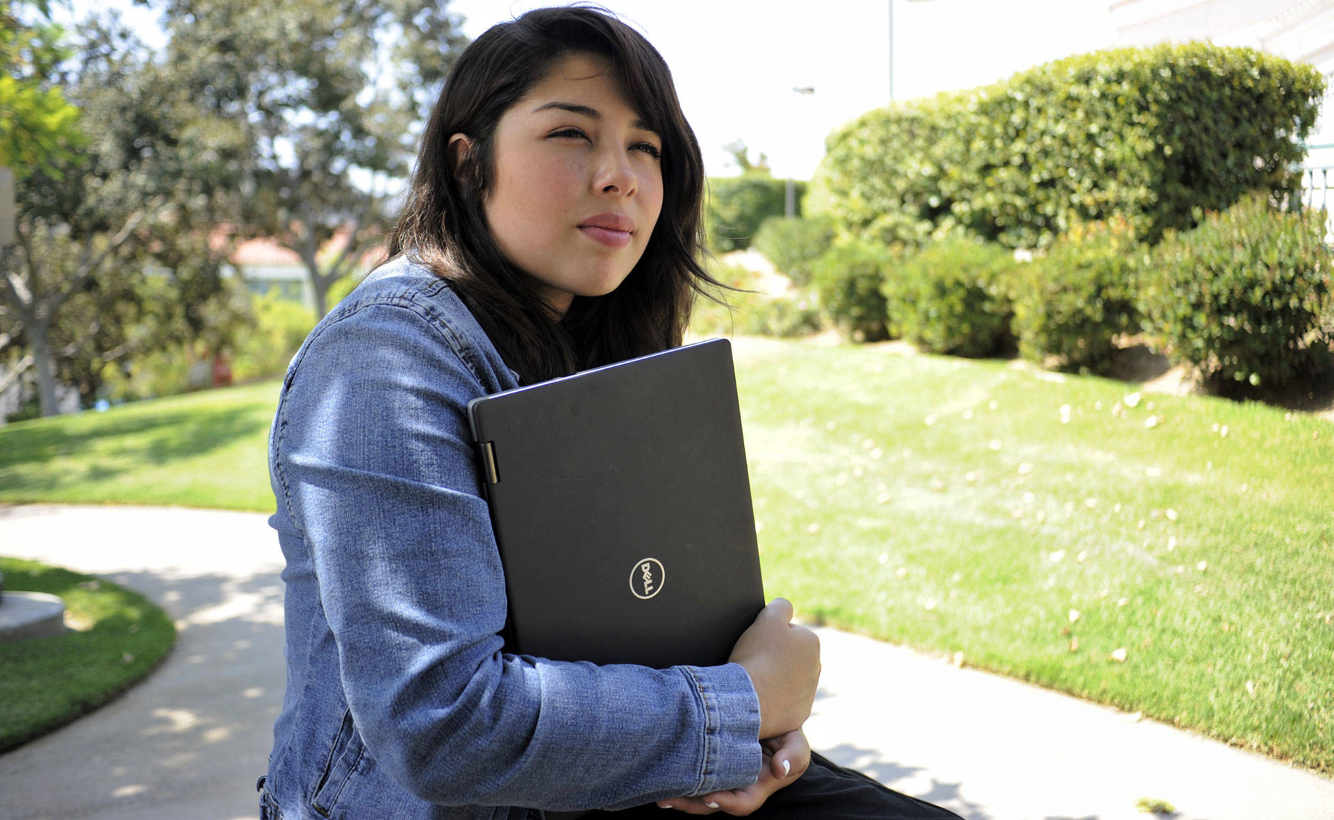 Dennisse Aldana, a student at Glendale Community College, received a refurbished laptop from iFoster. Blair Wells/KQED