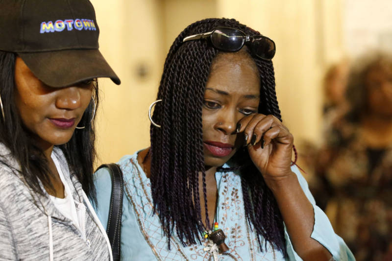 Kenneitha Lowe (R), sister of 'Grim Sleeper' victim Mary Lowe, wipes a tear in a downtown Los Angeles courtroom on June 6, 2016. At left is Tracy Williams, cousin of victim.