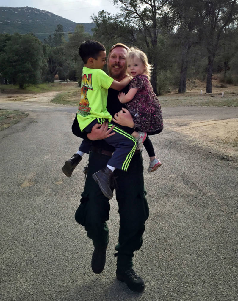 Jim Huston, superintendent of Laguna Interagency Hotshot Crew with the U.S. Forest Service, grabs his children Thomas, 7, and Hannah, 3. Hotshot crews can spend weeks at a time away from their families.