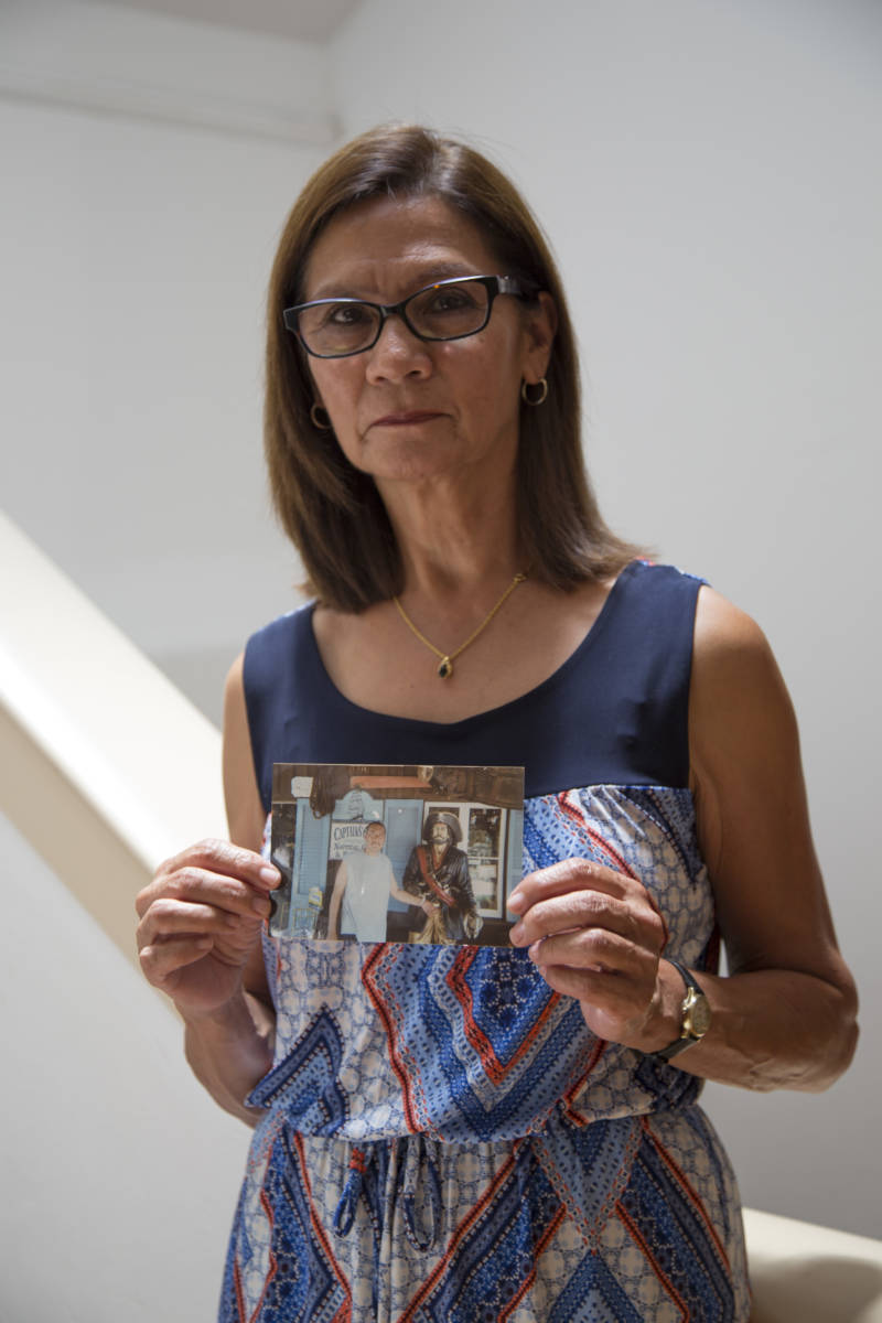Lydia Nunez holds a photo of her son Ruben.