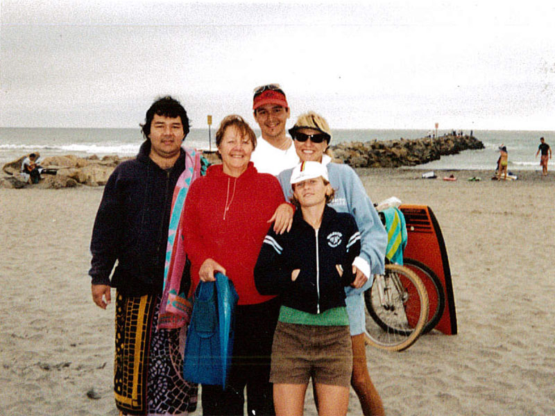 Jason Nishimoto (left) on the beach with family and friends.