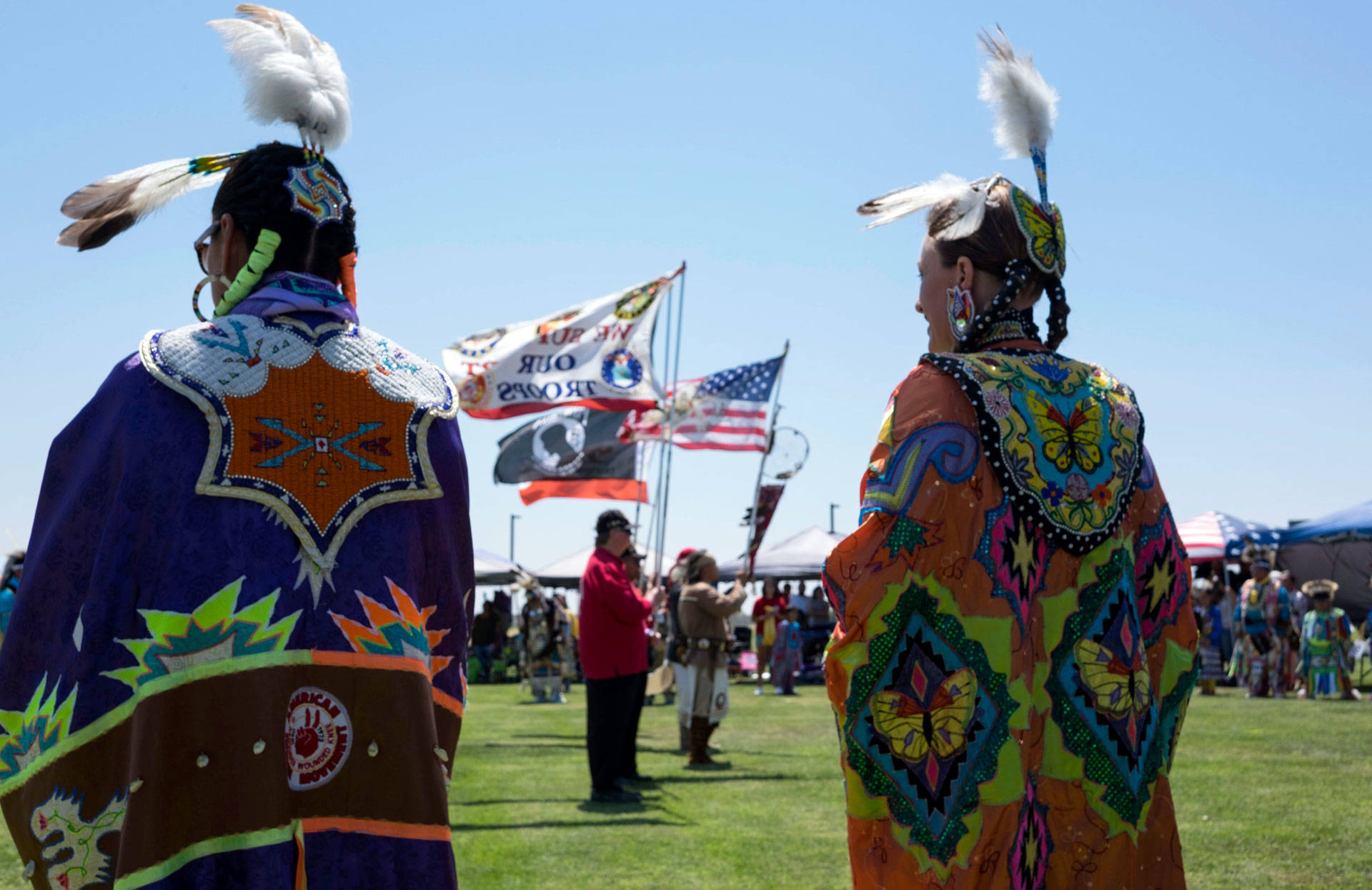Helen Gaddie (L) stands inside the dance circle during the Sierra Mono Museum's 45th annual powwow on August 6, 2016. Vanessa Rancano/KQED